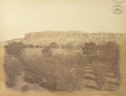 Distant view of south portion of east face of Gwalior Fort